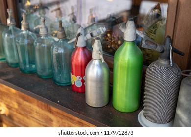 Old siphons for soda water. Home accessories from the last century set on the windowsill. Season of the autumn.