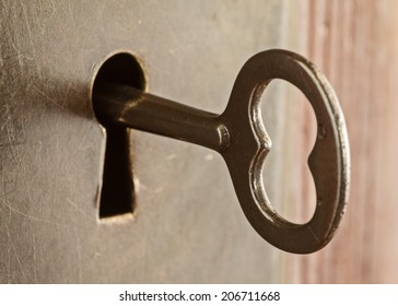 Old skeleton key in keyhole lock