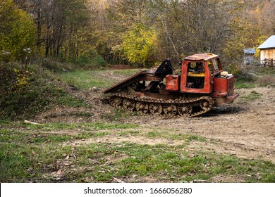 old skidder in the autumn forest