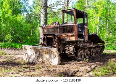 Old skidder at the forest in summertime. Skidding machine for timber industry