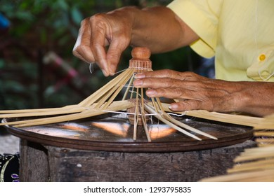 old skinny hands producing frames for a paper umbrellas in Chiang Mai