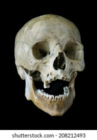Old skull of the person isolated on a black background.