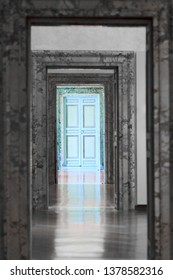 Old sky blue door and frames, symbolizing existential concepts like choice, change, stages of life, destiny, hope and the unknown. ROME, ITALY - APRIL 19, 2019