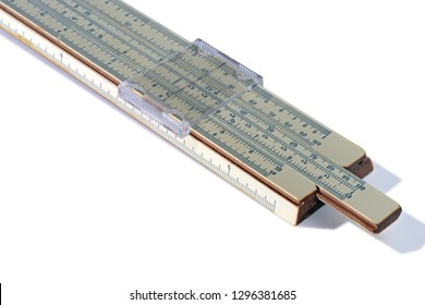 Old slide rule, mechanical calculator is isolated on white background. Vintage logarithmic ruler