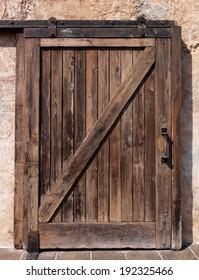 Old sliding wooden door rustic texture