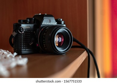 Old SLR Vintage camera Praktica B200 placed on a shelf. Wroclaw, Poland - October 22. 2019: 35mm film made by German company Pentacon between 1983 and 1985.