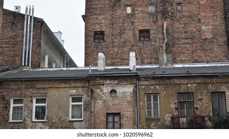 Old slum house with bullet holes from time of World War II in one of the poorest and dangerous districts of Warsaw. Location: Praga district, Warsaw, Poland