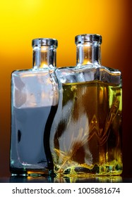 Old small bottles of flavored olive oil and balsamic vinegar .