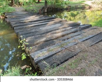 Old small bridge through a river