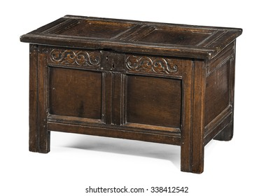 Old small coffer chest trunk early made from oak with detail carving and metal lock isolated with clipping path
