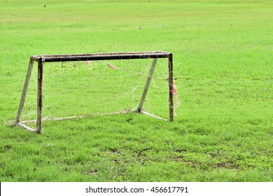 Old small goal football on grass.