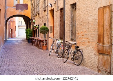 old small stone medieval street in historical center of Ferrara, Italy