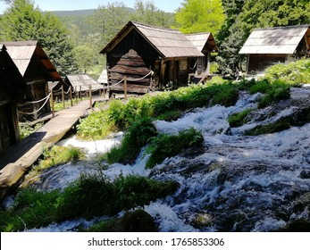 Old small wooden water mills called Mlincici by the Pliva lakes near the Jajce town in Bosnia and Herzegovina