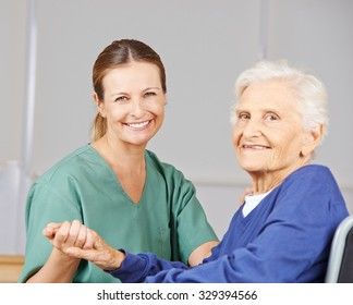 Old smiling senior woman with geriatric nurse in a nursing home