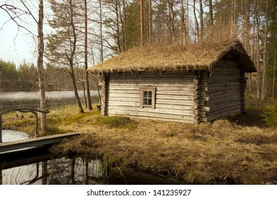Old smoked sauna building on the lake bank, Finland, region Etela-Karjala