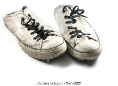 old sneakers on white background