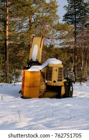 Old snow mower parked by a country road