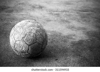 Old soccer ball the cement floor, Vintage style