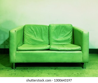 An old sofa in green monochrome