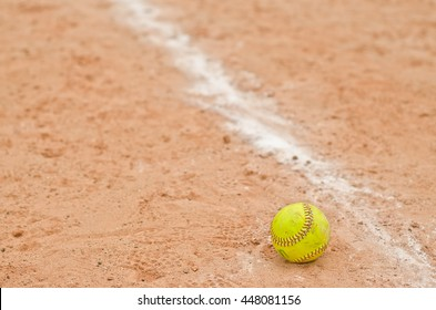 old softball in field,old softball in play,play softball