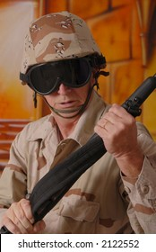 Old soldier with sniper rifle wearing desert camouflage