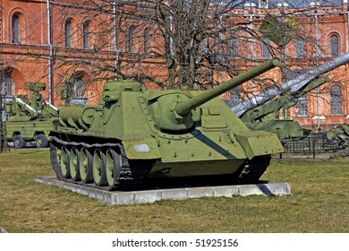 old soviet battle tank near the red building