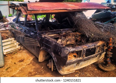 An old soviet car in the Russian junkyard