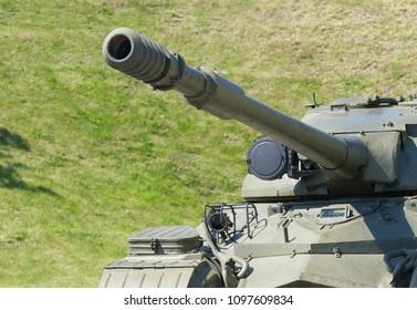 Old Soviet tanks - focus on gun .