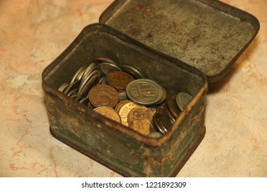 Old soviet union coins collection numismatic in shabby green tea box on marble background