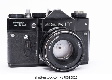 Old Soviet Zenit TLL 35 mm film camera isolated on white with Helios 44-2 lens