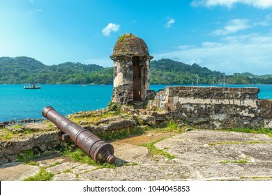 Old Spanish cannon at the fortress ruin of Santiago with a view over the Caribbean Sea in Portobelo near Colon, Panama, Central America.