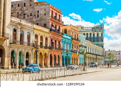 Old Spanish colonial living colorful houses across the road in the center of Havana, Cuba