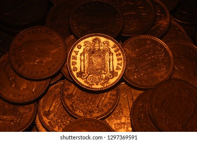 Old spanish Peseta's of the 1970's decade. The coin on the center has the Saint John's Eagle used on the spanish flag until  1980's. and it's facial value is 1.