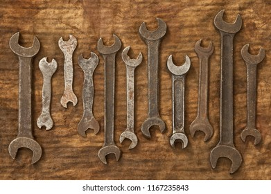 Old spanners on oily rag texture background