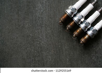 Old spark plugs on the black table
