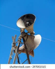 old speakers on a pole