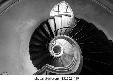 Old spiral staircase. View from above. Black and white.