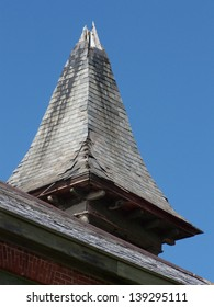 Old spire on top of a church in great need of repair and renovation