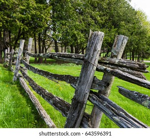 old split rail fence  gray with age and covered with lichen creating boundaries