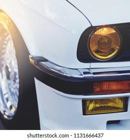 old sport car yellow headlights