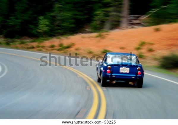 Old sportscar on a curvy road