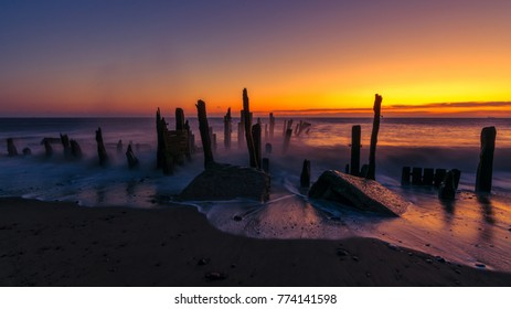 Old Spurn Point beach sea defences at sunrise
