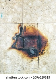 The old square rubber tile floor was burned.