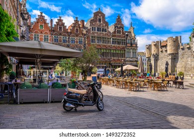 Old square with tables of cafe in Ghent (Gent), Belgium. Architecture and landmark of Ghent. Cozy cityscape of Ghent.