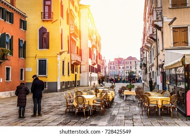 Old square in Venice, Italy. Street restaurant.