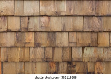 Old stack wooden tile panel wall background.