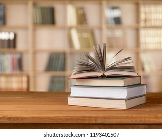 Old stacked books on wooden table