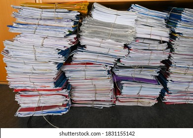 old stacks of files bound together with rope