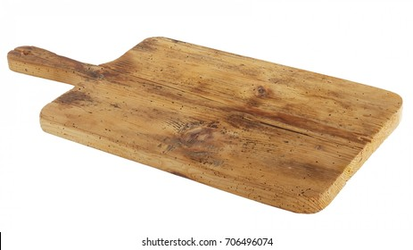 Old stained clean empty rectangular wooden cutting board isolated on white in an oblique low angle view for food placement