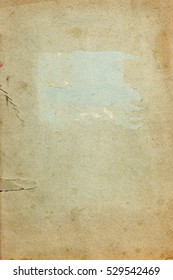 Old stained torn copybook cover page